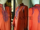Orange linen with machine embroidery on front and back